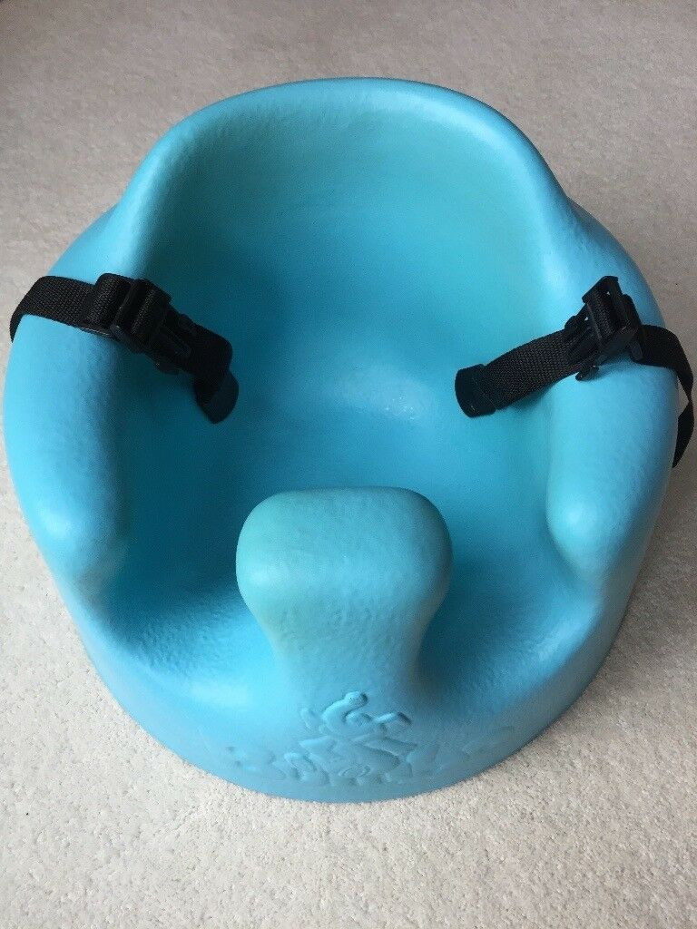 Blue Bumbo seat with safety harness