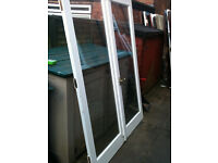 Double wooden doors with large double glazed panels (small misted patch on the one piece of glass)
