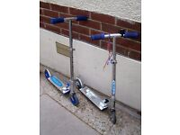 2 children's foldaway scooters, adjustable height.