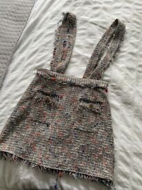 Tweed style skirt with braces