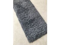Lovely long grey runner rug