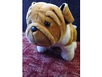 soft bulldog like toy dog, sitting, very good condition, light brown colour
