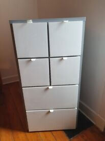 Tall grey and white chest of drawers