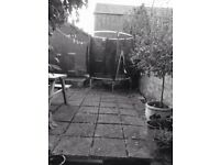 Small trampoline (Plum) for sale good condition -will fit in small garden