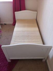 Children's white wooden cot bed with mattress