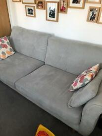 Three seater sofa with cushions