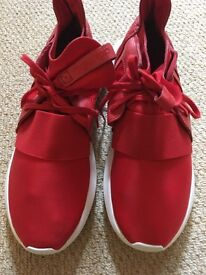 Red Addidas trainers