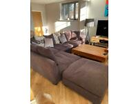 Large dark brown corner sofa and foot stool (from Barker and Stonehouse)