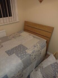 2 x single beds with wooden heads and mattresses .very good condition