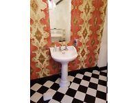 Bathroom bath sink and toilet vintage style
