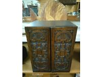 Antique cupboard with carved doors