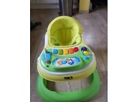 Baby walker with feeding tray