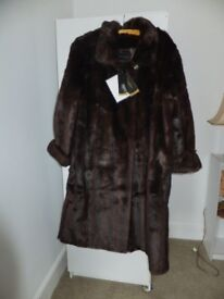 Dennis Basso Fur Coat. Brand new with tags and protective cover