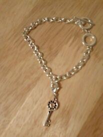 Charm bracelet with key charm