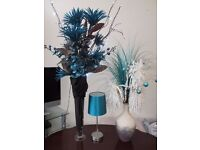 Two Teal Coloured Flower Arrangements and a Table Lamp