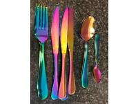 16 Piece iridescent cutlery set includes 4 knifes 4 forks 4 large spoons & 4small spoons.