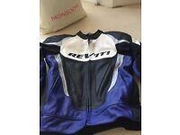 Men's leather REV,IT engineered skin blue, black, grey and white motorcycle jacket.