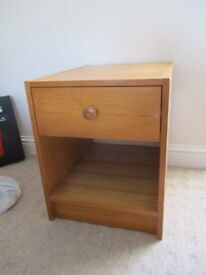 Pine colour bedside table with 1 drawer and cubby hole. Good condition.