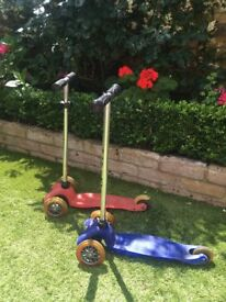 2 Mini micro scooters for sale - one red and one blue - £15 each