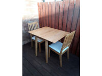 drop leaf pine wood table with 2 chairs