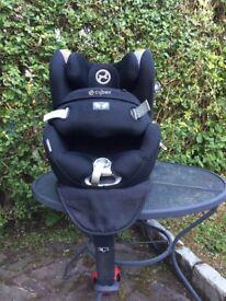 Rotating extended rear facing car seat
