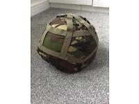 Army helmet with camo cover