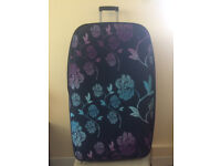 Large flower patterned suitcase