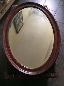 Oval dark wood mirror