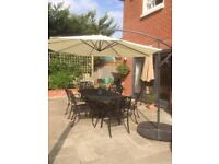 Cantilever patio umbrella and weights