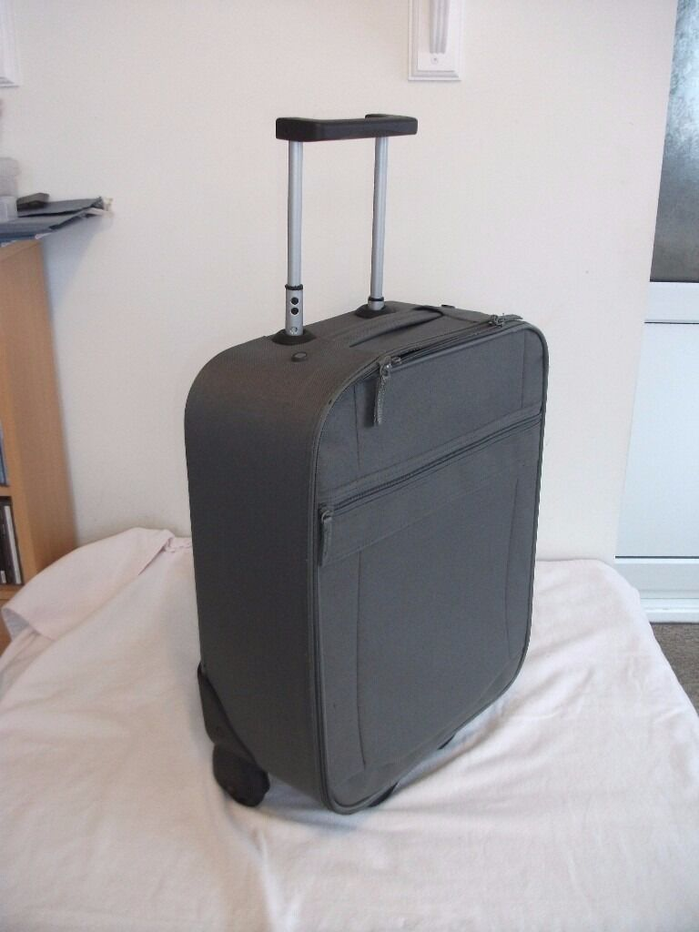 Small Suitcase on wheels with handle, also includes a holdall ...