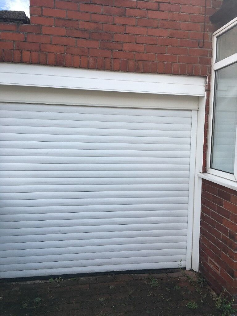 Electric Roller Garage Door With Remote In Reddish Manchester