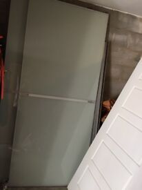 Sliding wardrobe doors and track