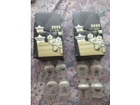 8 Tommee Tippee bottles with original boxes