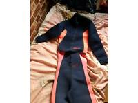 2 wetsuits size 10- 12 size large