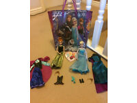 Elsa & Anna dolls + full change of clothes each + Frozen ceramic heart tree decoration & Frozen bag