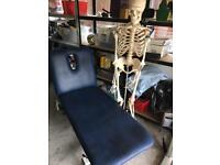 Therapy treatment couch skeleton and pictures