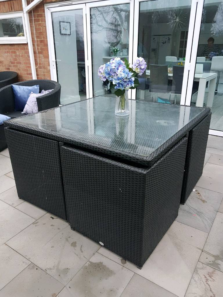 Black rattan 4 seater glass top table and chairs with footstools