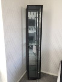 Two black glass cabinets