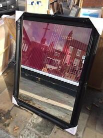 large black swept wood framed mirror