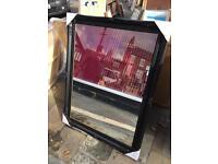 large black swept wood framed mirror