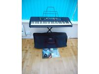 "Yamaha Portatone PSR-195 keyboard stand & power unit, manual, songbooks, ""Keybags"" carry case"