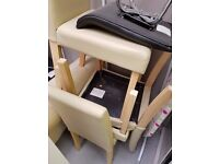 Dining table and four cream leather-effect chairs - very good condition