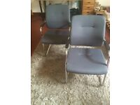 pair of grey arm chairs.