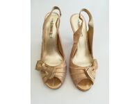 Next size 6 Gold heeled sling back peep toe shoes.
