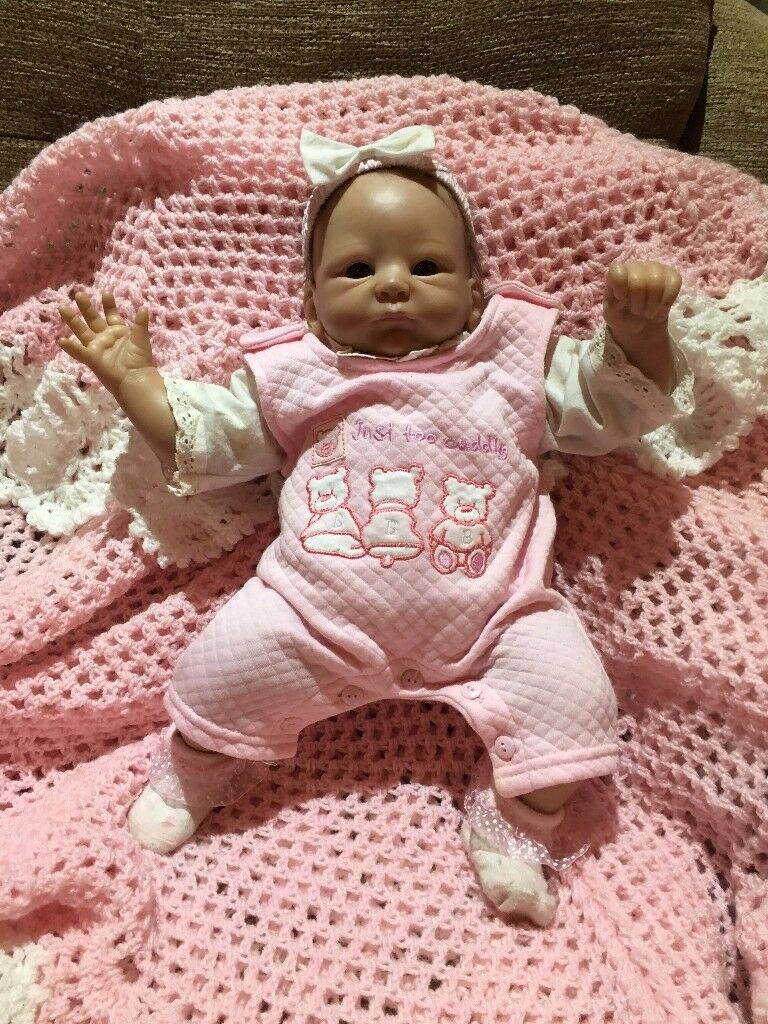 Reborn doll, lovely girl, includes outfits and accessories