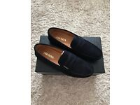 Prada Shoes brand new with original box size 8 but can fit size 9