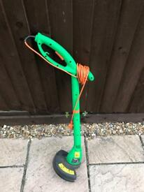 Grass trimmer in working order