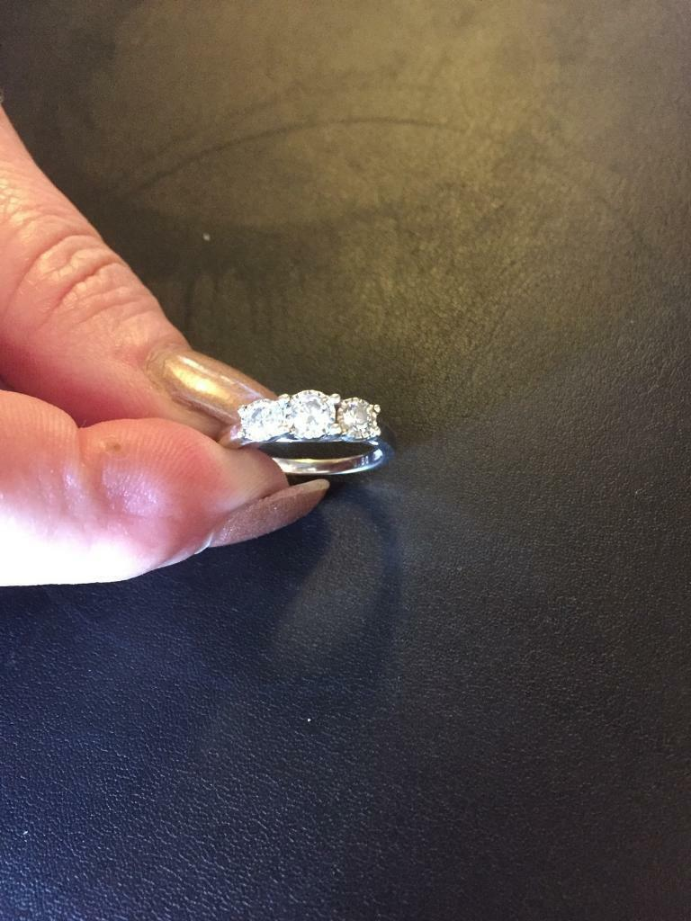 Engagement ringin Rotherham, South YorkshireGumtree - This beautiful Engagement ring with three set diamonds in a white gold ring ,would grace the finger of any lucky lady. Comes with identity card and box, the size is an M