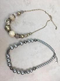 Accessorize gold and silver pearl and diamanté necklaces.