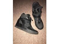 Trainer heels - size 5